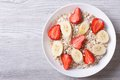 Muesli with fresh strawberries and banana horizontal top view Royalty Free Stock Photo