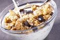 Muesli and milk with raisins for breakfast Stock Photo
