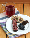Muesli snack bar, blueberries and berry tea Stock Photography