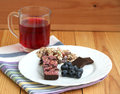 Muesli snack bar, blueberries and berry tea Stock Photos