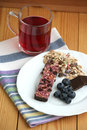 Muesli snack bar, blueberries and berry tea Royalty Free Stock Photo