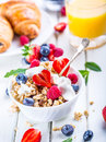 Muesli with yogurt and berries on a wooden table healthy fruit and cereal brakfast Royalty Free Stock Photography