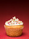 Muffin with colorful candy Stock Photo