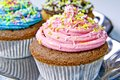 Muffin decorated with pink cream Royalty Free Stock Photos