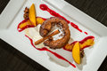 Muffin dessert adorned with peaches and cinnamon Stock Images