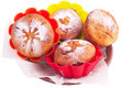 Muffin with icing sugar star heart and sun in color forms over white Royalty Free Stock Photo