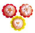 Muffin with icing sugar star heart and sun in color forms over white Royalty Free Stock Photos