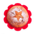 Muffin with icing sugar star in red form over white Royalty Free Stock Images