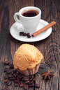 Muffin with nuts and coffee cup of on wooden table Royalty Free Stock Images