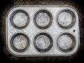 Muffin pan background Stock Image