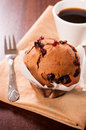 Muffin time homemade and cup of dark coffee selective focus on the Stock Photography