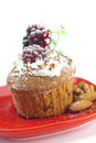 Muffin with whipped cream and berries Stock Photos