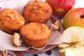 Muffins with apple and cinnamon muffin apples sticks on the kitchen Stock Photography