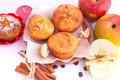 Muffins with apple and cinnamon muffin icing sugar star sticks on the kitchen Stock Photo