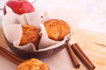 Muffins with apple and cinnamon red sticks on wood background Royalty Free Stock Image