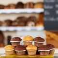 Muffins arranged on tray stack of at bakery Royalty Free Stock Images
