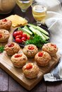Muffins with cheese, cottage cheese and tomatoes, vegetables and cheese served with wine