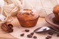 Muffins with cinnamon sticks on the kitchen Royalty Free Stock Photo