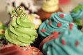 Muffins with colorful cream and sprinkles Royalty Free Stock Photo