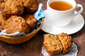 Muffins and cup of tea carrot apple raisin nut Stock Photography