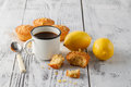 Muffins and fresh lemons on wooden table Royalty Free Stock Photo