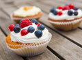 Muffins with fruits on wooden board Royalty Free Stock Photography