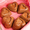 Muffins in a heart shape  on a white Royalty Free Stock Images