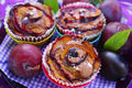 Muffins with plums in rose shape delicious and fresh fruits Stock Image