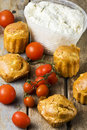 Muffins Ricotta Tomatoes on Rustic Table Stock Photos