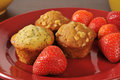 Muffins and strawberries assorted mini fresh on a plate Royalty Free Stock Photos