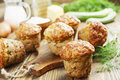 Muffins with zucchini, cheese and herbs