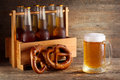 Mug of beer with bottles in wooden box Royalty Free Stock Image