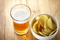 Mug of beer and chips snack drinks Stock Photos