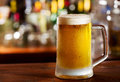 Mug of beer cold in a bar Stock Image