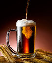 Mug of beer foamy poured into the jug Stock Photography