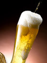 Mug of beer foamy poured into the jug Royalty Free Stock Photo