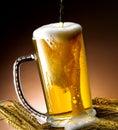 Mug of beer foamy poured into the jug Stock Photography