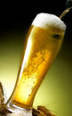 Mug of beer foamy poured into the jug Royalty Free Stock Photography