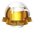 A mug of beer with a fresh beer label Royalty Free Stock Photography