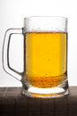 Mug of beer a frothy isolated on a white background Royalty Free Stock Image