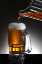 Mug of Beer and Pitcher Pour Royalty Free Stock Image