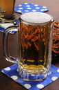 Mug of beer and pretzels Royalty Free Stock Images