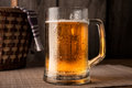 Mug of beer on wood background Stock Photos