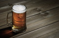 Mug of beer on wooden background Royalty Free Stock Photo