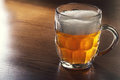 Mug of beer on wooden table Stock Photography