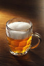 Mug of beer on wooden table Royalty Free Stock Images