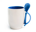Mug with blue spoon Stock Photos