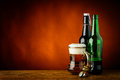 Mug and bottles of beer still life with text copy space Royalty Free Stock Photo