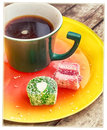 Mug with coffee and candy two multi colored Royalty Free Stock Photo