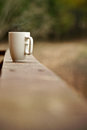Mug of coffee on a ledge or wall Stock Photo